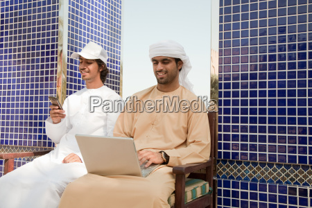 two middle eastern men with laptop