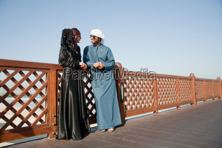 middle eastern people and fence outdoors