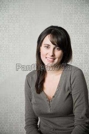 portrait of teenage girl wearing gray