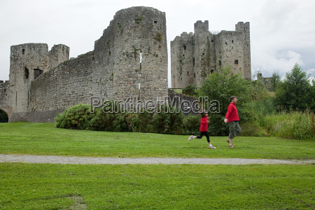 father and daughter running at trim