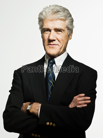 studio portrait of confident senior businessman