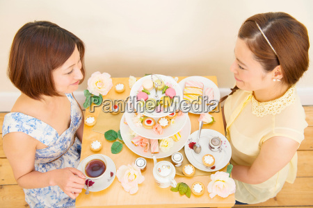 two women having tea and teatime
