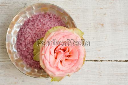 rose and bowl of bath salts