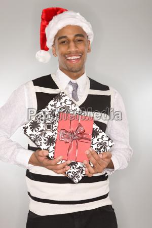 young man wearing a santa hat