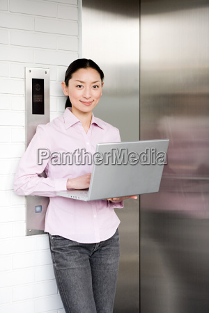woman using a laptop computer outside