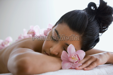 young woman on massage table with