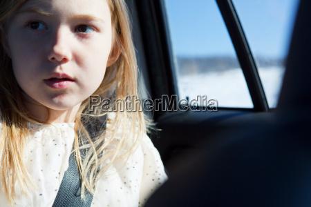 young girl wearing car seatbelt