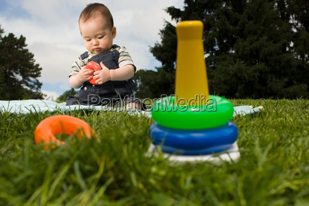 baby, boy, in, park, with, toy - 18665872