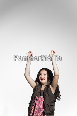 happy girl with arms raised