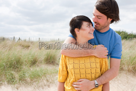 young couple at the coast