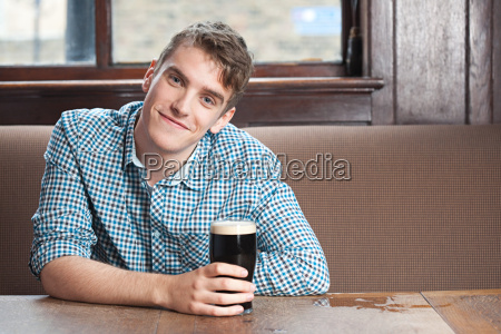 young man in bar