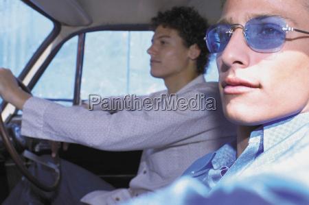 men driving in car