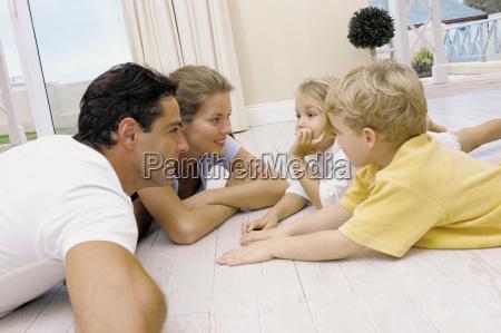 family lying on the floor