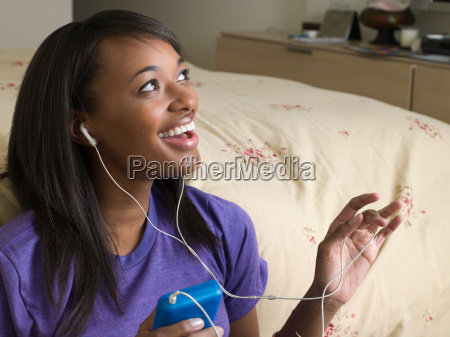 happy woman with mp3 player