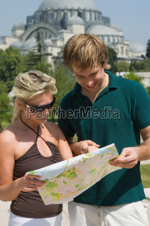 couple in istanbul with map