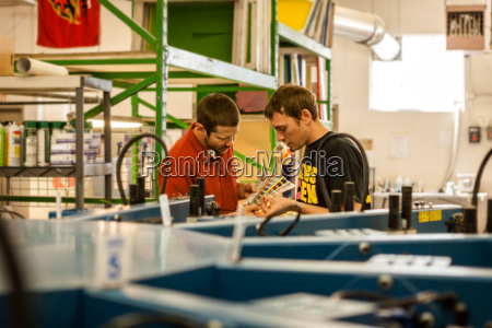 workers checking color swatches in screen