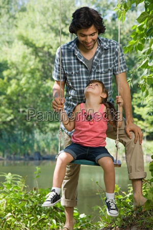 father and daughter on swing