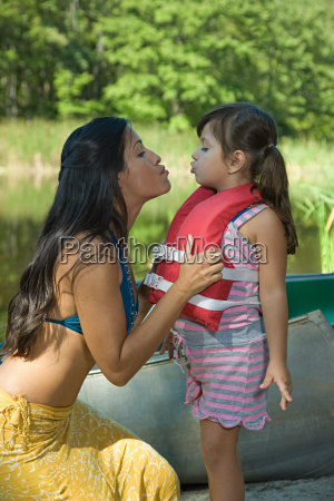 mother and daughter making kissing faces