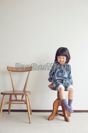 girl sitting on stool portrait