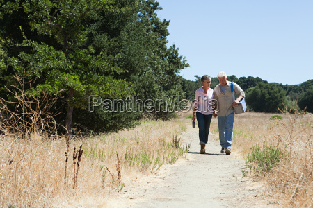 mature couple walking on rural path