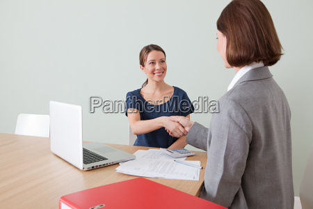 young woman shaking hands with financial