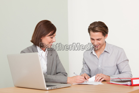 young man with financial adviser