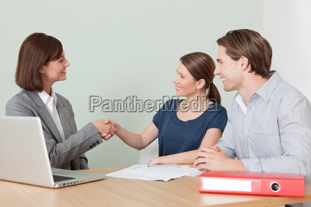 young couple with financial adviser