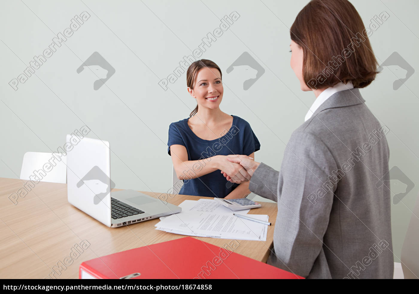 young, woman, shaking, hands, with, financial - 18674858