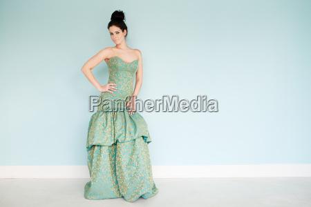 young woman wearing green wedding dress