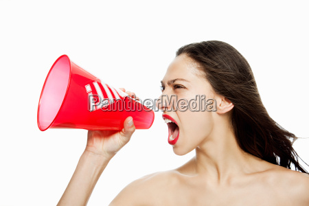 woman shouting into red megaphone