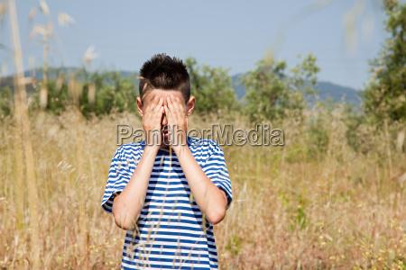 boy playing hide and seek in