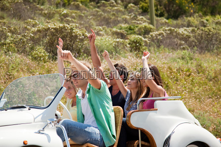 young friends in convertible car