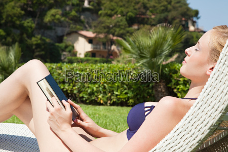 young woman sleeping on sun lounger