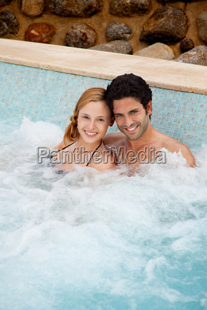 young couple in hot tub portrait