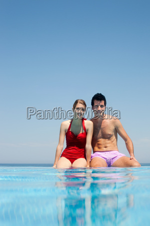young couple by swimming pool portrait