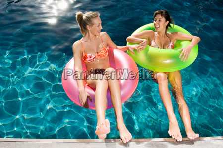 two young women in inflatable rings