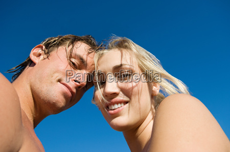 young couple looking at camera against