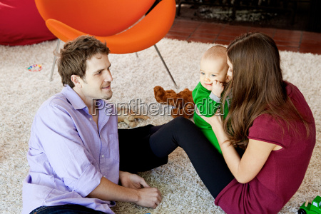 parents with baby son in living