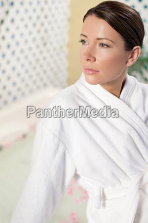 young woman wearing bathrobe