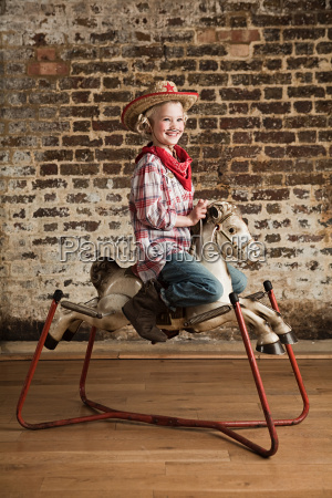 young girl dressed as cowgirl with