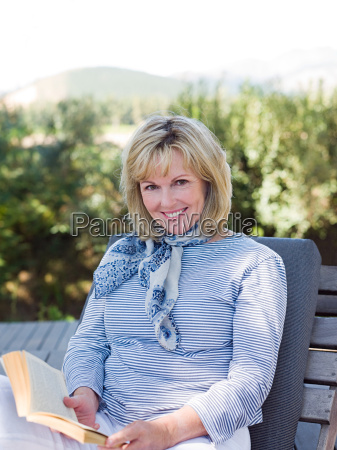mature woman on sun lounger with