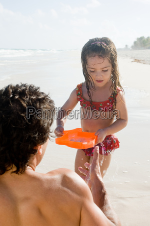a father and daughter playing on