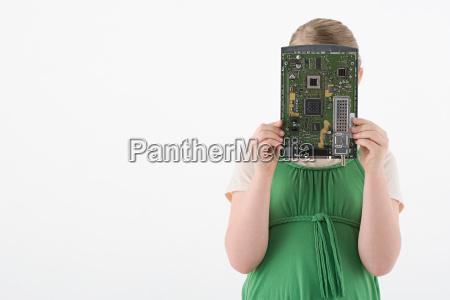 girl holding circuit board