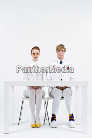 portrait of businesspeople wearing name badges