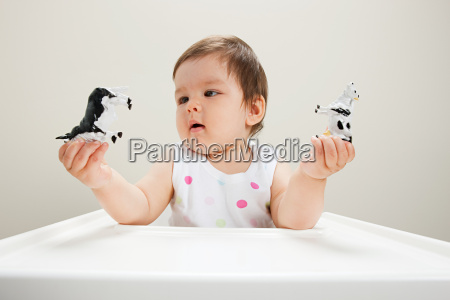 baby boy sitting in highchair with