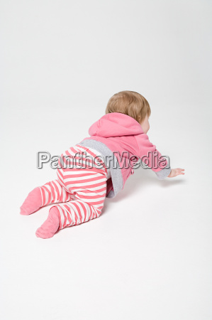 a baby girl crawling