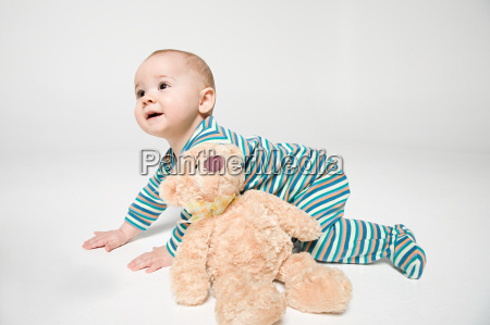 a baby boy and a teddy
