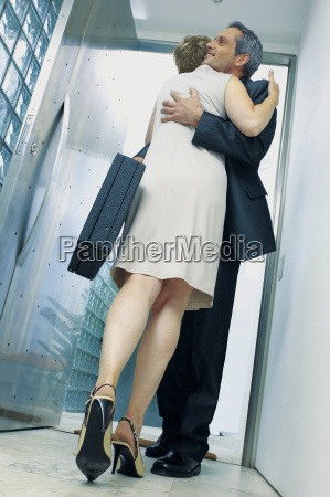 businessman and businesswoman embracing