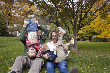 mid adult parents and young sons