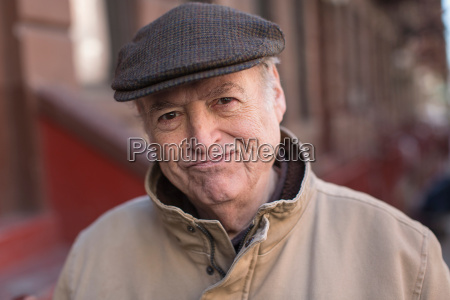 portrait of senior man in street